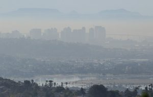a strong NW wind will export Los Angeles' worst byproduct down the coast. here a thick layer of smog blankets downtown.